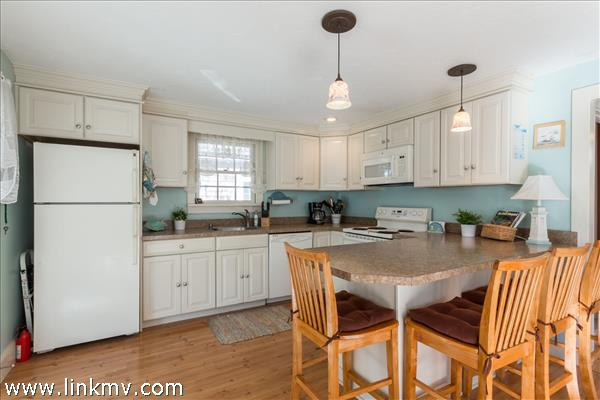 Spacious kitchen with ample seating at the breakfast bar.