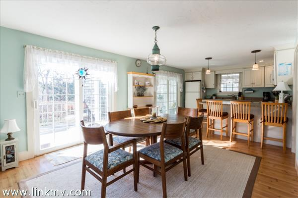 Open dining room and kitchen with sliders to the deck and 4 season sun room.