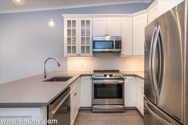 Galley Style Kitchen Has Stainless Steel Appliances
