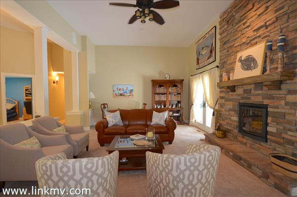 Open living area with wood burning fireplace!