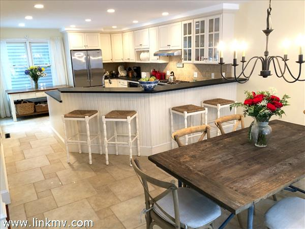 Kitchen & dining area with travertine tile
