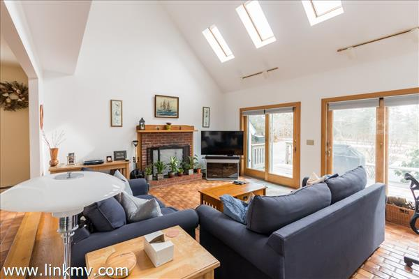 Bright and spacious vaulted ceiling living room with fireplace