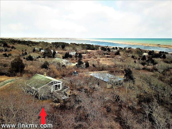 aerial view looking over Chilmark Pond to the Atlantic Ocean