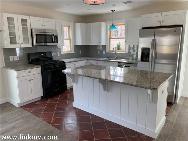 Kitchen with granite counter tops and center island seating