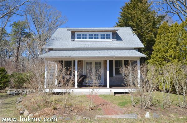 A Stylish One Bedroom Guest House accented by a nice Farmers Porch in front and large deck in the rear. Early Springtime.