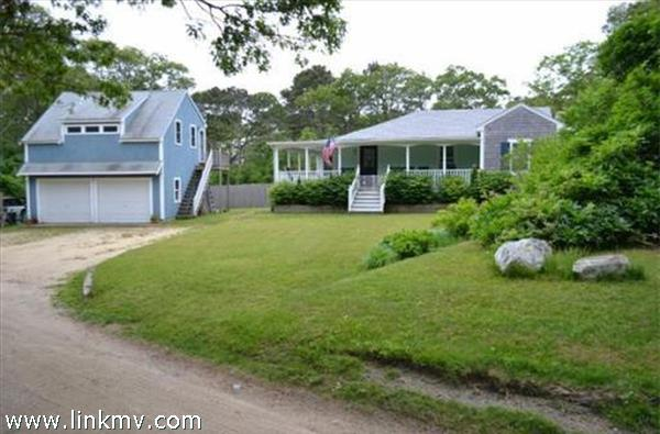 Proximity to town and the ferry with a main house and apartment above the garage.