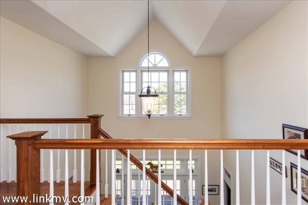 Second Floor Balcony Has Vaulted Ceilings and Overlooks First Floor Foyer