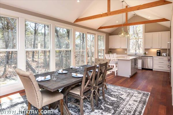 Open Dining and Kitchen Has Wall of Windows Overlooking Side Yard
