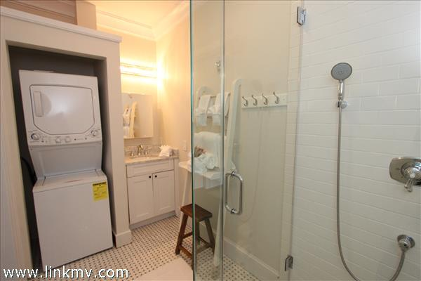 Bath with glass shower and laundry