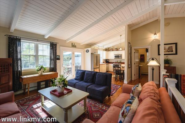 Open, bright living area on second floor with wide pine floors