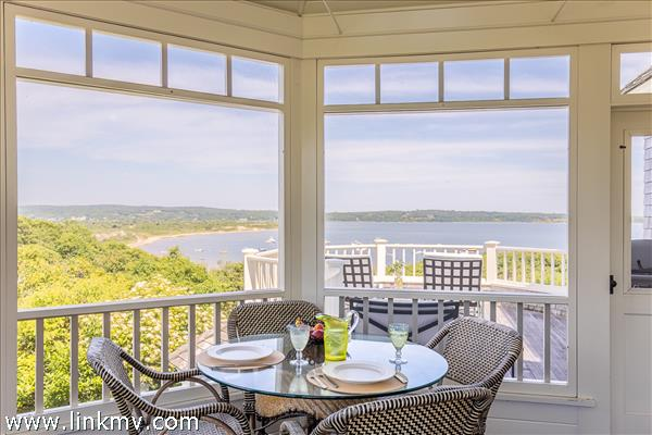 Screened porch offers an alternative eating area.