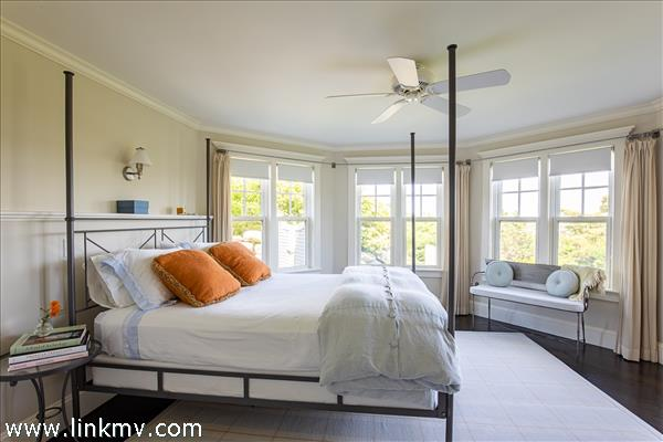 Guest bedroom 1 looks over the pool to Menemsha Sound.