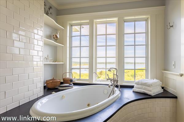 """Large master bathroom offers """"bathing with a view."""""""