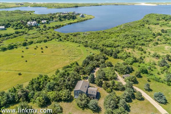 Extraordinary 4 acre opportunity on Herring Creek Farm with pond frontage and spectacular water views.