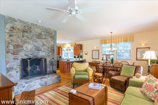Custom built field stone wood burning fireplace is the focal point of the living room.