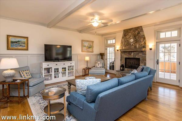 Living Room has handsome stone fireplace and two single French doors that open onto the Screened Porch.