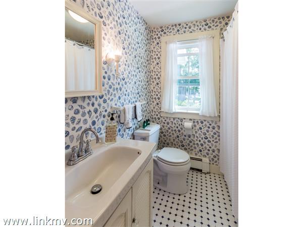 Full Bath with tile floors