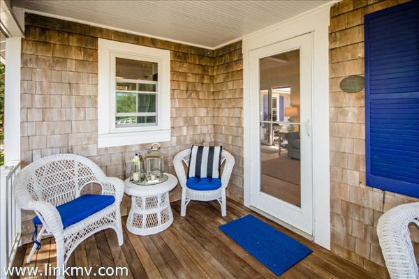 Front porch has room for friends and family and a welcoming front door
