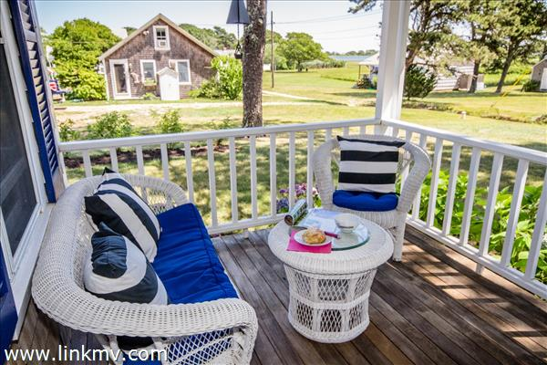 Relax on the front porch  -enjoy views of Sengekontacket Pond leading to State Beach.